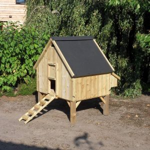 A wooden chicken coop on long legs